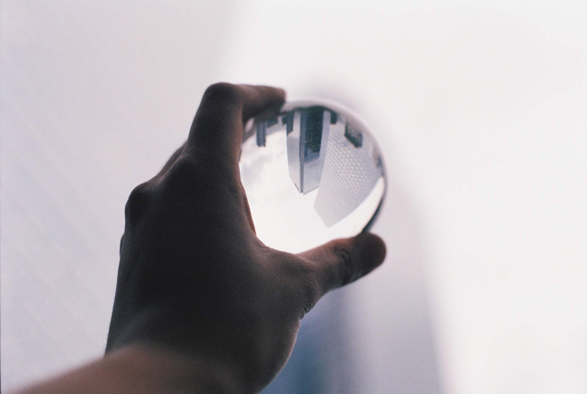 cityscape reflecting in glass ball