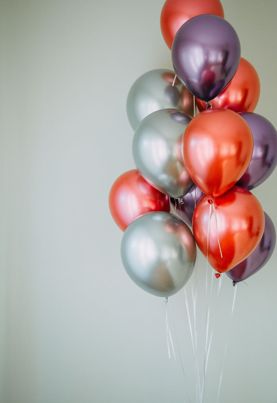 red and white balloons on white wall